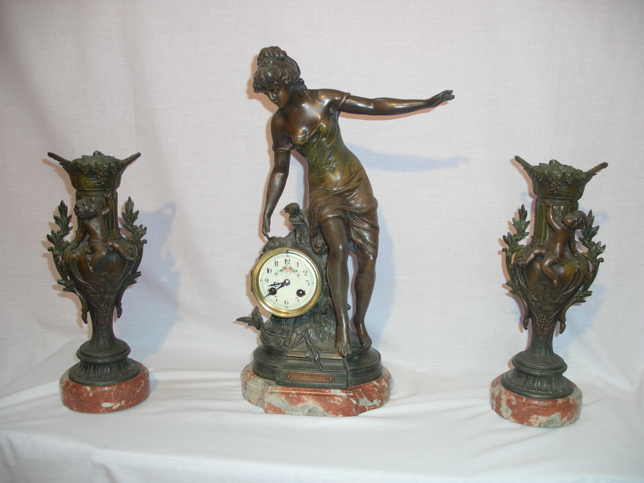 Marti, French clock garniture set
